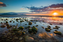 Evening Sun at Dinas Dinlle (Michael Sowerby Photography) Tags: dinas dinlle beach coast sea water sun sunset mountains lln peninsula northwales snowdonia evening light stones pebbles sand clouds landscape outdoor sky hills golden colour tide low