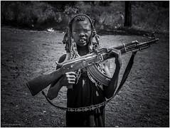 Mursi Tribe Warrior (Luc V. de Zeeuw) Tags: boy child ethiopia kalashnikov man mun mursi omo omovalley paint soldier tribe warrior weapon southernnationsnationalitiesandpeoplesregion