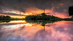 A great reflected sunset (dennis.dieleman) Tags: mill mills water reflection reflections sunset colors color sky skyporn upsidedown holland dutch netherlands heerhugowaard molen ringvaart canal old nature scenery landscape flat