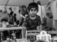 Immerse (pchida) Tags: kid kids focus concentrate blackandwhite immerse nikon photography photographer play