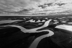 The Mackenzie River Delta Region (Isaac Hilman (@lifeofisaac)) Tags: mackenziedelta mackenzieriver water waterways lakes reflections wild nature forest nt northwestterritories canada monochrome travel clouds bw nikon d800