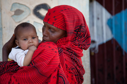 Sophia Ege Bulale carries her three month old grandson Hamad Mukhtar Dayib