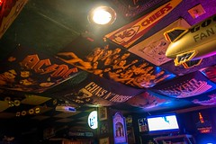Posters and flags adorn the ceiling at Skinny's Beer Garden.
