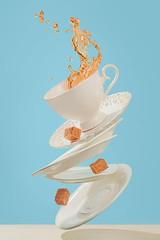 Coffee for stage magician (Dina Belenko) Tags: blue light food white cup coffee danger relax fun flying dance drops perfect risk tea vibrant magic flash levitation happiness drop stack sugar gourmet falling health gravity balance chance easy diet elegant splash minimalism conceptual sweetness pour saucer sugarcubes clever khabarovsk equilibrium madteaparty unbalanced productphotography dexterous frozenmotion apolloorb