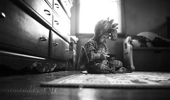 Taming the Dragon (taylormackenzie) Tags: baby kid child toddler son little small young black white monochrome lens flare dragon costume halloween depth focus dresser bedroom cell phone horns wings fantasy pretend play playing sitting indian style innocent cute adorable playroom rug hardwood window