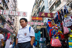 Sham Shui Po market, Hong Kong (jaumescar) Tags: street kid schoolboy hong kong city market urban fat boy chinese sign clothes candid uniform sony color travel local people
