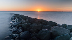 sunrise over sea (***stina***) Tags: outdoor ostsee sonnenaufgang steine buhne stone meer nikon sea sunrise available light romantisch langzeitbelichtung wasser water sonne sun
