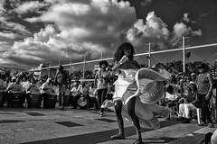 Dance under the clouds (Jaime Recabal) Tags: canon 40d sigma monochrome riopiedras recabal blancoynegro blackandwhite festivaldetambores2016 puertorico baile dance bailadora tambores musicos