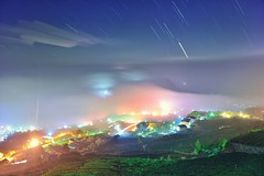 Misty village at tea field  (Vincent_Ting) Tags:             taiwan jiayi alisan formosa clouds sunset sky teafield seaofclouds    crepuscularrays vincentting  startrails