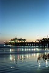 Santa Monica Pier (eyepenn) Tags: ocean california sunset night pier venus santamonica 50mm14 nikonf100 planets jupiter santamonicapier kodakportra400
