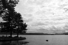 Supernatural (Megan Colleen) Tags: trees sky blackandwhite lake ny mountains water clouds landscape horizon silhouettes adirondacks speculator lakepleasant
