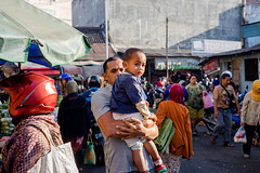 Salatiga Market | Father and Son going to the market (Ordinary_Folk) Tags: life red colour indonesia happy humanity market f14 sony voigtlander mc human colourful 40mm dailylife alpha a7 nokton element developingcountry salatiga