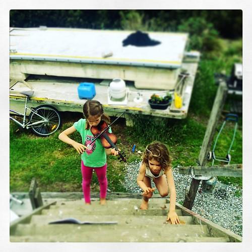302/365 • the joy of spring - violin practice outside, amongst the flotsam • #302_2015 #7yo #5yo #liveaboard #boatyard #violin #Spring2015 #sisters #suzuki #music #climbing