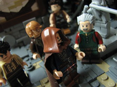 LoM UC: 7 (Micah the Fire-Breathing Hobbit) Tags: city roof horse statue wall soldier army riot hand lego stonework crowd medieval tudor cobblestone story fantasy hood cloak tale lom warg grueling