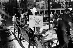 "Street Protest (Xsbmrnr (Please read profile before ""following"") Tags: gorepark blackandwhite bandw streetphotography street standingrock protest photojournalism olympusom1 om1 olympus hfg hamiltonflickrgroup police demonstration film trix trix400"