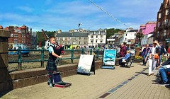 mini-piper in Oban (helenoftheways) Tags: people pavement candid argyll seagull oban piper bagpipes seafront boypiper