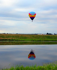 Hot Air Balloon in Reflection (Wits End Photography) Tags: blue red sky house reflection building green nature water pool field grass yellow clouds rural america landscape outside mirror illinois pond marine midwest colorful exterior view natural bright outdoor farm vibrant country agrarian rustic gray balloon lawn scenic vivid structure american vehicle airship hotairballoon homestead pastoral multicolored solitary picturesque grounds turf sod agricultural bold bucolic eyecatching countrified