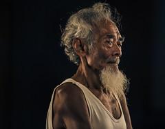 MIA_4562b (yaman ibrahim) Tags: old portrait mist kid smoke palm smoking suluk nikond4 tausug