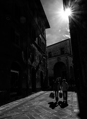 More streets of Citt della Pieve (Georgie Pauwels) Tags: sunlight light shadows street streetphotography candid bags blackandwhite cittdellapieve italy moment