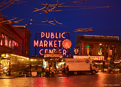 Pike Place Market about Dawn [0781] (Chris S. Collison) Tags: seattle pikeplacemarket sign publicmarketsign trolleywires reflection
