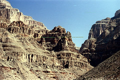34-680 (ndpa / s. lundeen, archivist) Tags: nick dewolf nickdewolf color photographbynickdewolf 1970s 1973 film 35mm 34 reel34 arizona northernarizona southwesternunitedstates grandcanyon coloradoriver raftingtrip raftingexpedition mountains canyonwalls rock rocks rocky terrain landscape scratch scratches scratched sky bluesky cliff cliffs canyon 1972