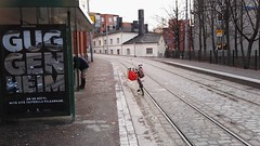 Something there? (olmofin) Tags: helsinki guggeheim bicycle tram streetcar tracks guy deposit katajanokka skatta