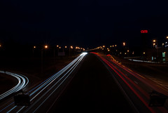 Linear (modestmoze) Tags: night nightphotography dark nightscene nightsky 2016 november autumn 500px outside outdoors out lines light poles cars moving going architecture buildings shops road grass trees sky blue atnight red white green shadows black brown many city vilnius lithuania