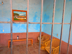 Bright blue interior behind a barred gateway in Talpa, one of Mexico's Pueblos Magicos in the Pacific high sierras (albatz) Tags: sierramadre westcoast buildings talpa mexico pueblosmagicos pacific high sierra wall bright jalisco town