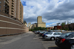 Rail bed under Third Avenue, pre-woonerf - parking lot (schwerdf) Tags: cloudscapes millingdistrict minneapolis minnesota northstarwoollenmill washburnamill