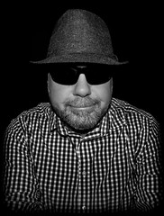 Nice hat. (CWhatPhotos) Tags: photographs man male portrait self selfie me mine smile checked shirt checky hat tweed trilby wool fisheye view prime night time have it photograph pics pictures pic picture image images foto fotos photography artistic that which contain digital dark cwhatphotos 9mm bodycap body cap 9 mm lens olympus e5 mk2 omd shades sunglasses sun glassses specs