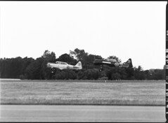 Swedish Airforce Historic Flight; 2x North American Harvard/Texan (holtelars) Tags: blackandwhite bw 120 film monochrome analog mediumformat denmark 645 pentax harvard d76 300mm airshow northamerica analogue 6x45 danmark roskilde texan 400iso f40 foma pentax645 filmphotography jobo fomapan autolab fomapan400 classicblackwhite 645n homeprocessing fomapan400action filmforever smcpentax67 atl1500 larsholte fotodioxp67top645adapter
