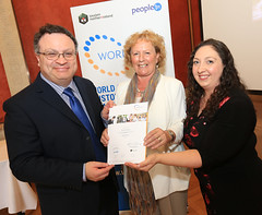 Brenda Robinson, Robinsons Catering, Newcastle is presented her WorldHost Principles of Customer Service achievement certificate by DEL Minister Dr Stephen Farry and Licensed WorldHost Trainer Christine Watson at the Watson & Co. Chartered Marketing 2015