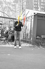 Juggler BW (thoth1618) Tags: park christmas nyc newyorkcity red orange ny newyork yellow december manhattan pins plastic bowling juggling juggler bowlingpins bryantpark 2015