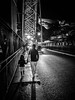 Bridge Crossing (Doug Knisely) Tags: street bridge bw portugal contrast walking crossing daughter mother olympus porto pedestrians littlegirl backlit carheadlights 1517 omdem5markii