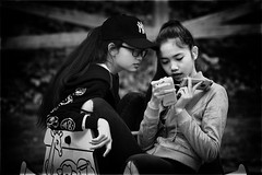 Talking to herself? (Frank Fullard) Tags: frankfullard fullard candid street portrait mobile iphone one two girl lady text