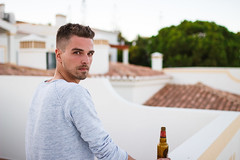 Portugal Impressions (thethomsn) Tags: guy man portrait person male beard grey faded dof portugal sigma 30mm eyes face bottle beer