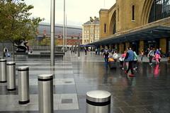 Rain Front (dhcomet) Tags: kings cross station train railway transport great northern st pancras wet rain rainy bollard london
