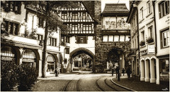 Freiburg im Breisgau (VandenBerge Photography) Tags: freiburgimbreisgau badenwrttemberg germany europe oldtown ancienttown mono blackandwhite sepia cityscape schwabentor blackforest vintage