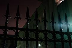 Behind the Fence (Yoan Mitov) Tags: sofia bulgaria night rainy rain street fuji fujifilm xt10 27mmf28 27mm fence green violet sky light