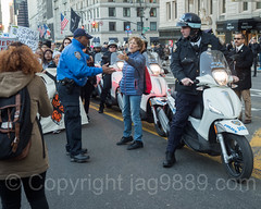 Anti-Trump Protesters march on Central Park South, New York City (jag9889) Tags: jag9889 president signboard demonstration manhattan banner people rally 20161113 outdoor 2016 policeofficer centralparksouth immigrants donaldtrump 59thstreet scooter newyork elect text midtown immigration newyorkcity march nypd usa sign trump motorcycle protester cop finest firstresponder lawenforcement ny nyc newyorkcitypolicedepartment officer police policedepartment unitedstates unitedstatesofamerica us