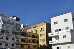 appartments (curly_em) Tags: bluesky blue buildings building concrete pastel loscristianos tenerife canaryislands outside yellow appartments white railings balconies