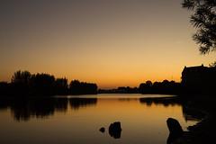 sunset river (bjdewagenaar) Tags: trees sunset sky sun holland reflection water colors dutch contrast reflections river dark landscape twilight raw sundown sony clear alpha outlines lightroom waterscape gorinchem a58