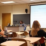 A student gives a presentation to her class about her experience at an internship.
