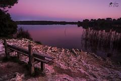 Solitudine (lulo92) Tags: sky sun lake water landscape ross long solitude italia tramonto rosa cielo sole puglia hitech lecce lunga esposizione panchina solitudine alimini filtri expositure acqau
