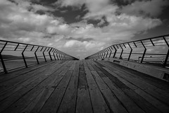 Take me there... (ImagesByLin) Tags: vanishingpoint canon greatoceanroad blackwhite clouds dramatic jetty leadingline mono monochrome moody