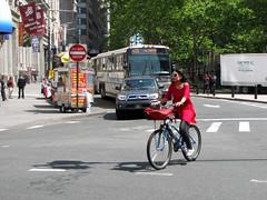 Bowling Green Cyclist (Multielvi) Tags: new york city nyc ny manhattan street candid bicycle bike bus broadway woman bowling green park