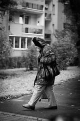 Daily misery (salahudin's paragnomen) Tags: krakw krakoff street people woamn old aging bw 123bw lady tired weary walking steps salahudin