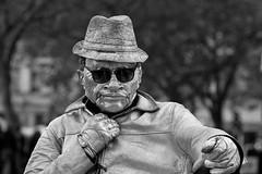 Living statue portrait, London (chrisjohnbeckett) Tags: livingstatue portrait bw blackandwhite monochrome mask sunglasses shades lunettesnoires urban street streetperformer performer entertainer london londonist timeout trafalgarsquare chrisbeckett canonef135mmf2lusm attitude
