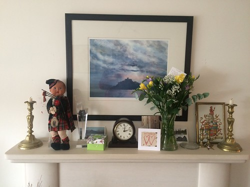 Mantle piece with piper and flowers