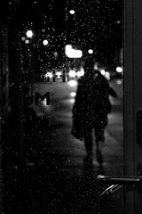 Into the rain (Kimmo Risnen) Tags: noir moody grainy blackandwhite monochrome night rainy canoneos10d helsinki finland silhouette